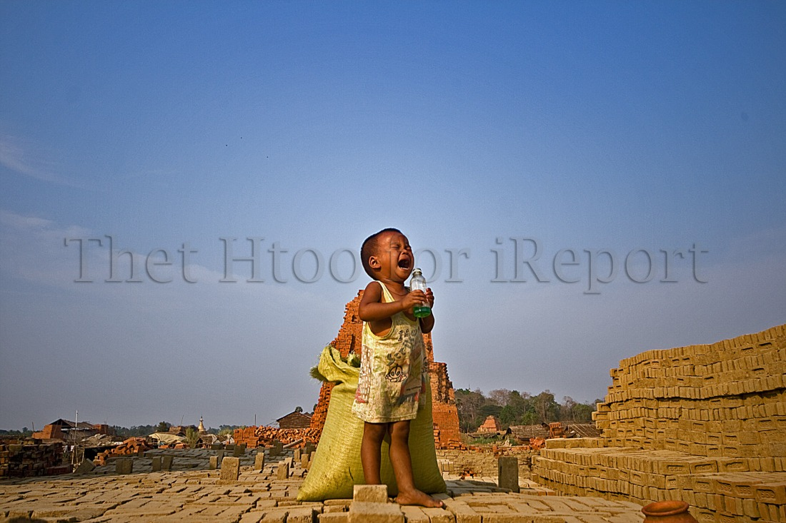 Child at brick making field